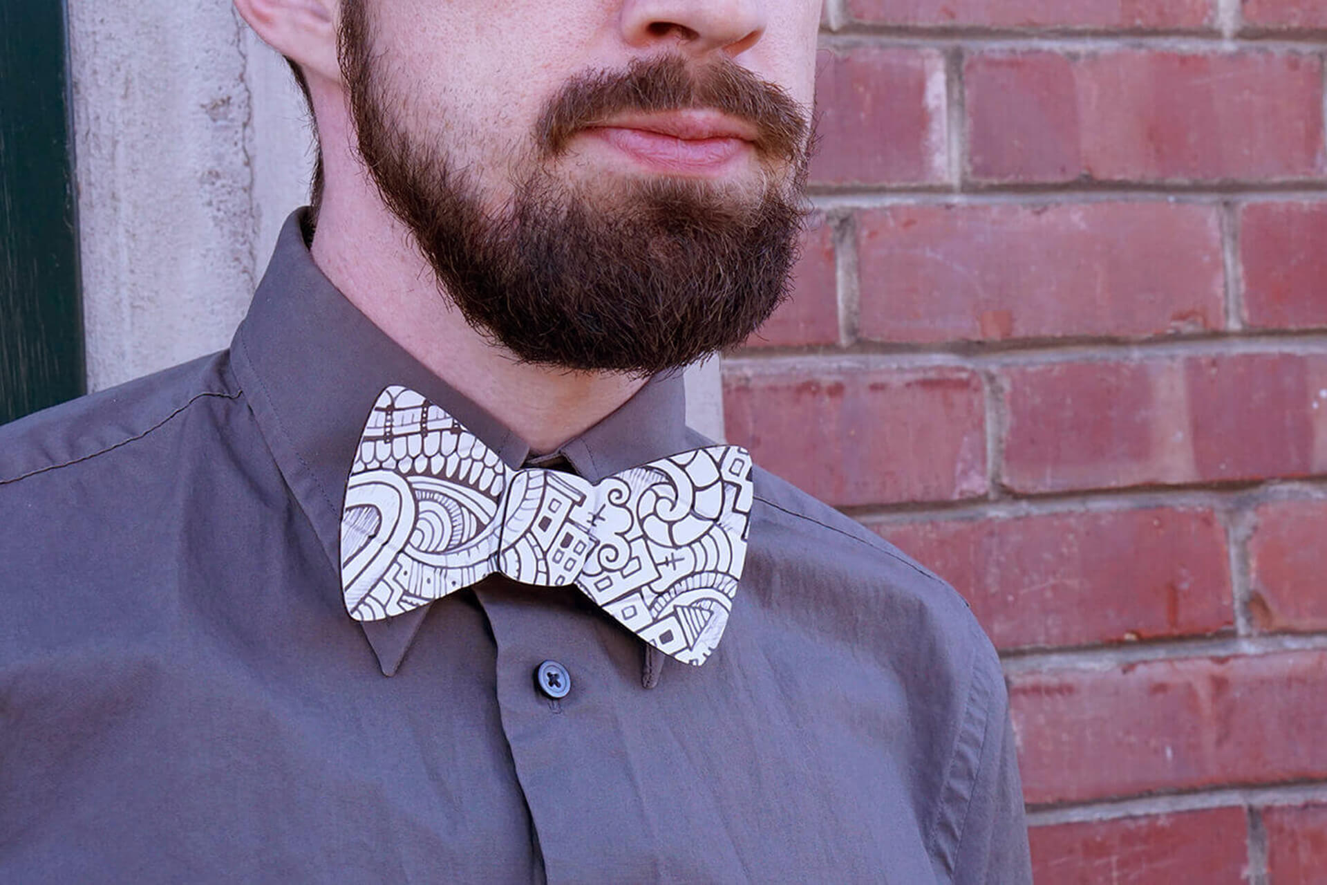 A lifestyle shot of the cardboard doodle bow tie