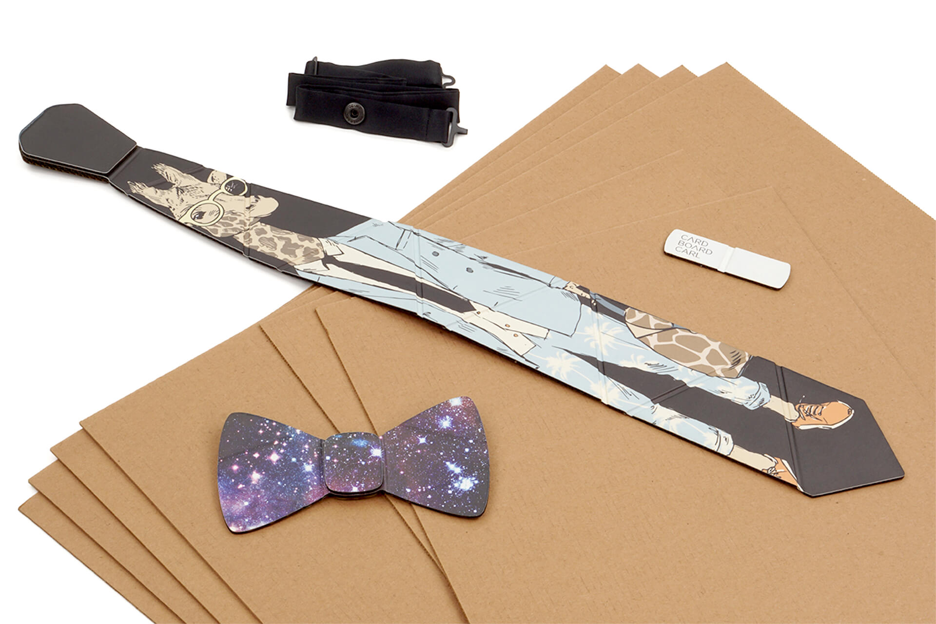 A cardboard neck tie and bow tie resting on cardboard sheets